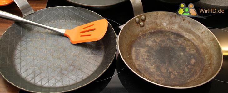 Eingebrannte Eisenpfannen.